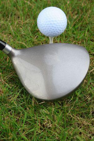 sportsperson: Driver, golf ball, grass and a tee peg Stock Photo
