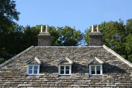 typically english: Traditional stone roof with three windows