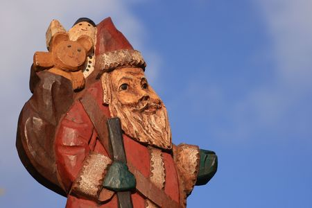 Wooden father christmas or santa claus photo
