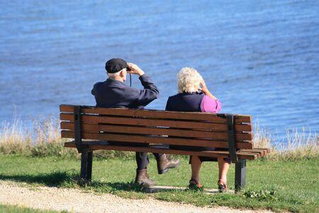 Retired couple enjoying the view to sea photo
