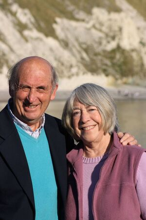 Mature smiling couple with sea and chalk cliff coastline in the backround. Stock Photo - 2005395
