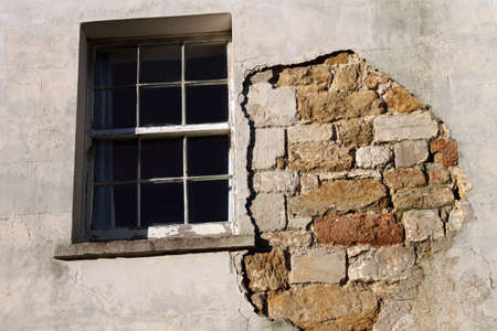 sash: Old sash window and wall with missing render.  Stock Photo