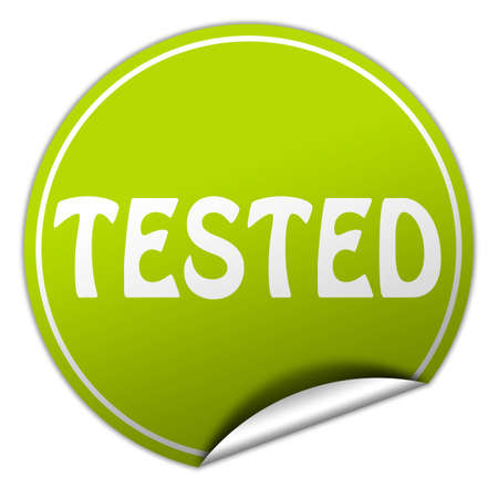 acception: tested round green sticker on white background