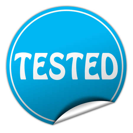 tested round blue sticker on white background photo