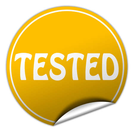 tested round yellow sticker on white background Stock Photo - 25159373