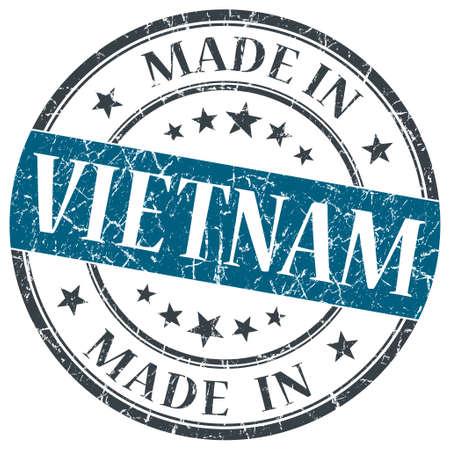 made in Vietnam blue grunge round stamp isolated on white background photo