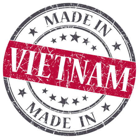 made in Vietnam red grunge round stamp isolated on white background photo