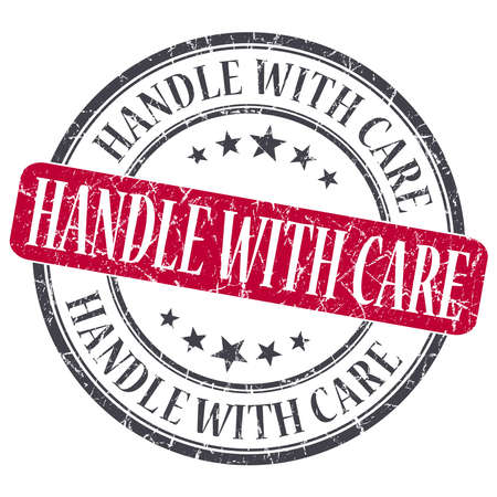 Handle With Care red grunge round stamp on white background photo