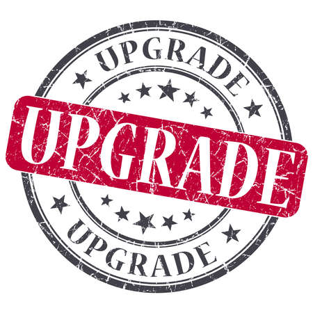 Upgrade red grunge round stamp on white background photo
