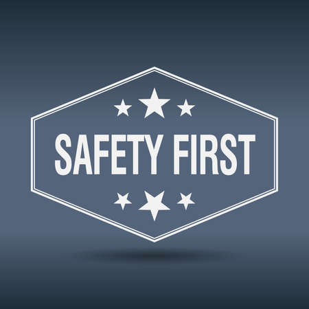 safety first hexagonal white vintage retro style label Vectores
