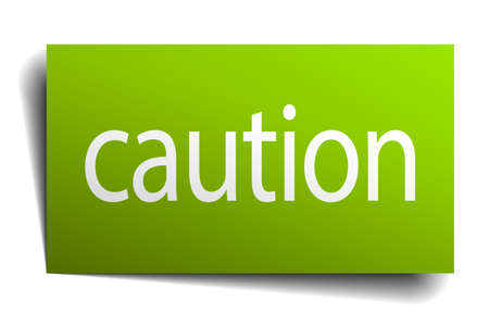 green paper: caution green paper sign on white background