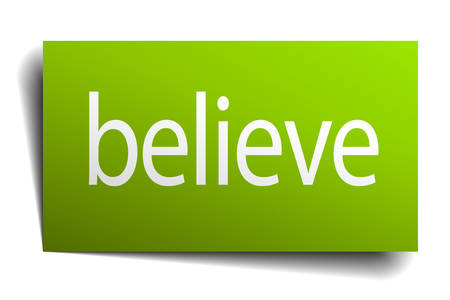 green paper: believe green paper sign on white background