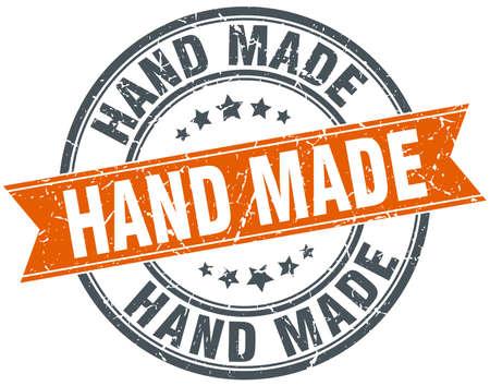 hand made: hecho a mano ronda naranja aislados grungy sello de la vendimia
