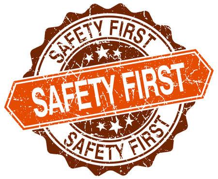 safety first: safety first orange round grunge stamp on white