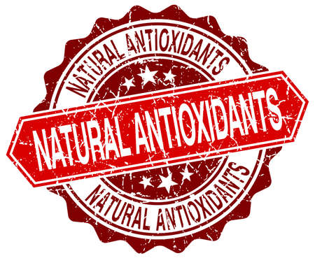 antioxidants: natural antioxidants red round grunge stamp on white Illustration