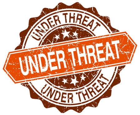 threat: under threat orange round grunge stamp on white Illustration
