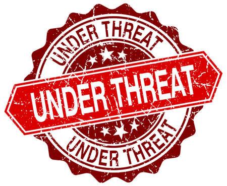 threat: under threat red round grunge stamp on white