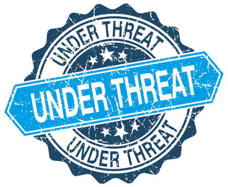 threat: under threat blue round grunge stamp on white
