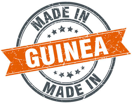 guinea: Guinea orange grunge ribbon stamp on white