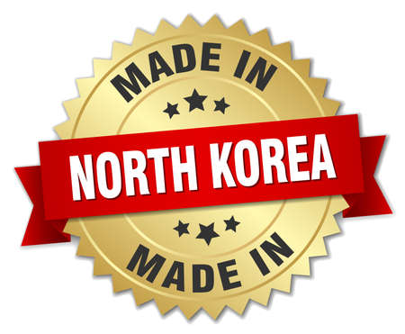 north korea: made in North Korea gold badge with red ribbon