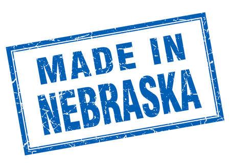 em: Nebraska blue square grunge made in stamp