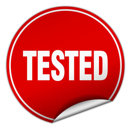 tested: tested round red sticker isolated on white