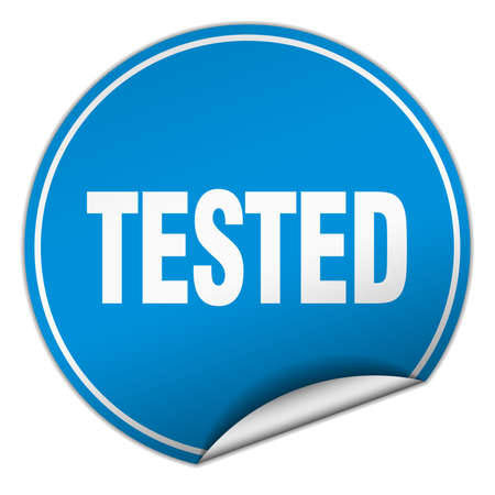 tested: tested round blue sticker isolated on white