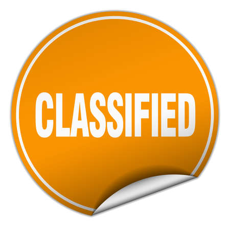 classified: classified round orange sticker isolated on white