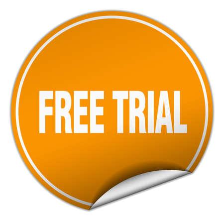 free trial: free trial round orange sticker isolated on white