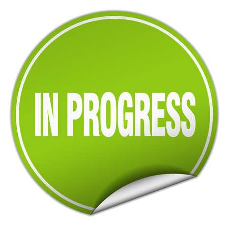 em: in progress round green sticker isolated on white