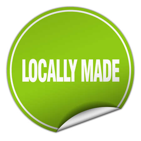 locally: locally made round green sticker isolated on white