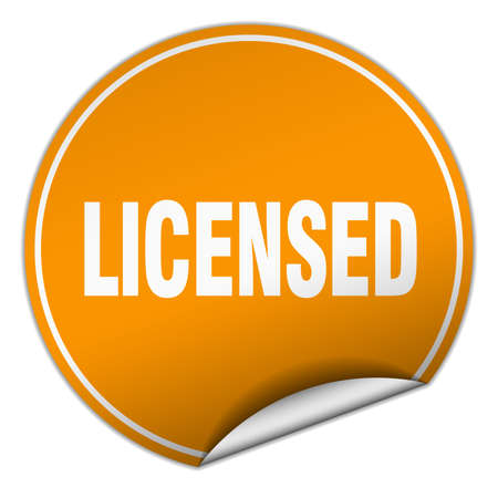 licensed: licensed round orange sticker isolated on white