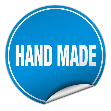 hand made: hand made round blue sticker isolated on white