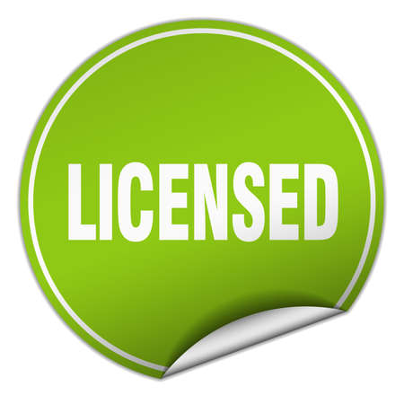 licensed: licensed round green sticker isolated on white