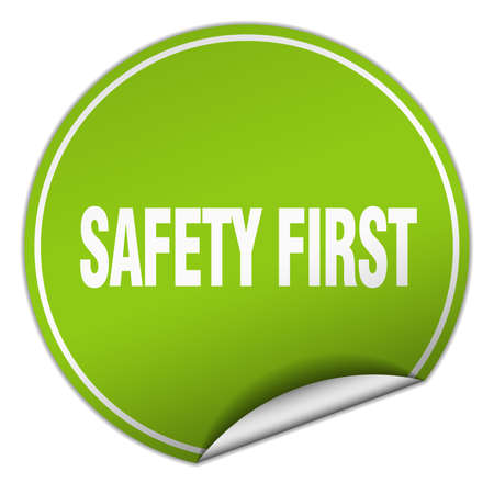 safety first: safety first round green sticker isolated on white