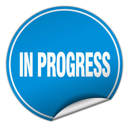 em: in progress round blue sticker isolated on white Ilustra��o