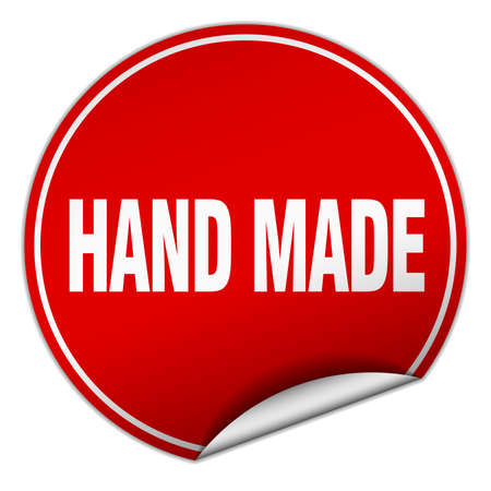hand made: hand made round red sticker isolated on white