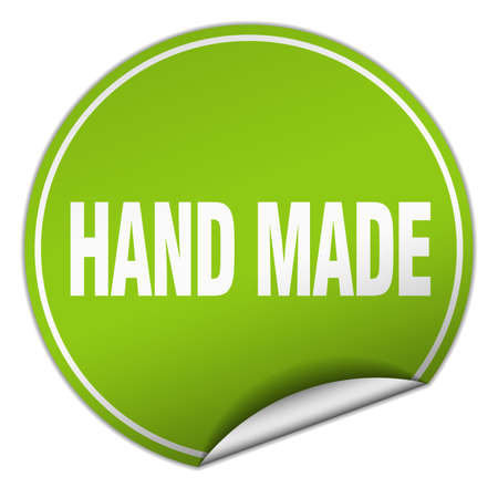 hand made: hand made round green sticker isolated on white