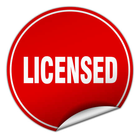 licensed: licensed round red sticker isolated on white