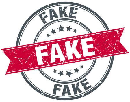 fake: fake red round grunge vintage ribbon stamp