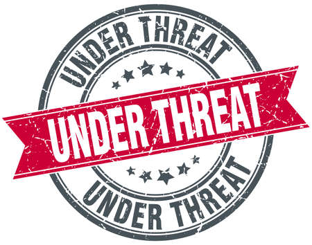 threat: under threat red round grunge vintage ribbon stamp