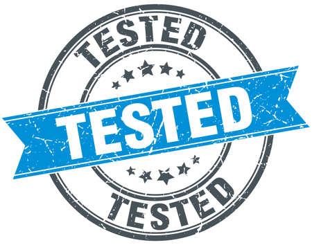 tested: tested blue round grunge vintage ribbon stamp
