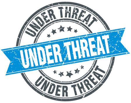 threat: under threat blue round grunge vintage ribbon stamp