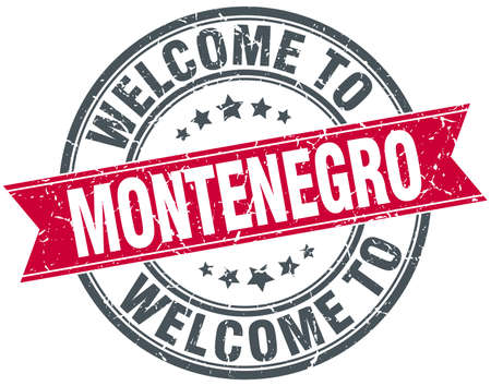 welcome to Montenegro red round vintage stamp