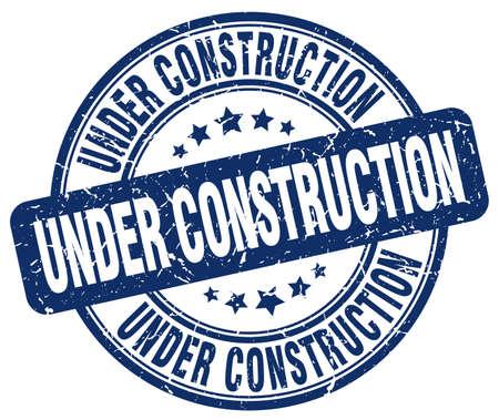 under construction blue grunge round vintage rubber stamp