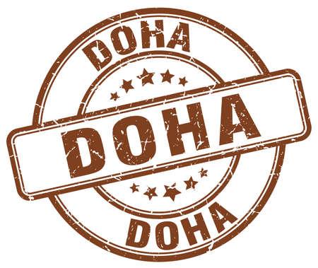 doha: Doha brown grunge round vintage rubber stamp.Doha stamp.Doha round stamp.Doha grunge stamp.Doha.Doha vintage stamp.