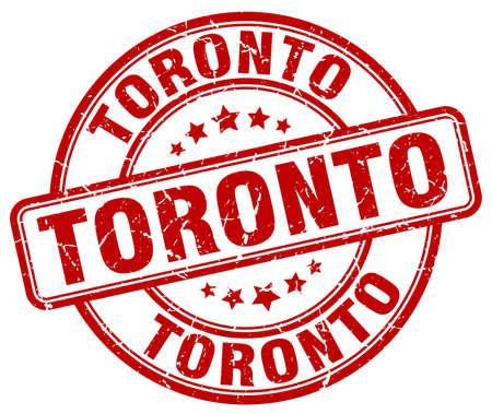 toronto: Toronto red grunge round vintage rubber stamp.Toronto stamp.Toronto round stamp.Toronto grunge stamp.Toronto.Toronto vintage stamp.