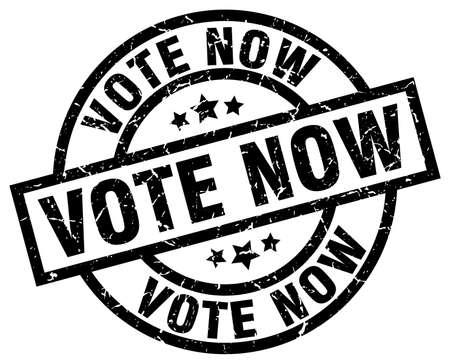 Vote now round grunge black stamp.