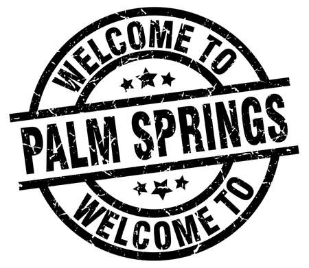 A welcome to Palm Springs black stamp.