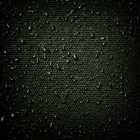 Water drops on the fabric texture. wet textile texture. cloth with water drops. moist fabric pattern. Stock Photo